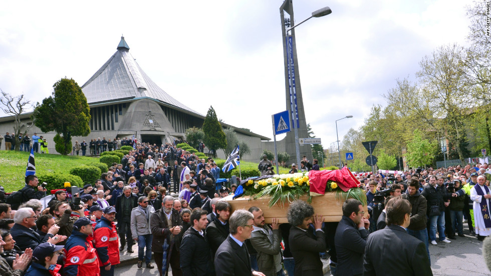 Distraught mourners follow the coffin of Piermario Morosini at the funeral service at the Church of San Gregorio in Bergamo on Thursday.