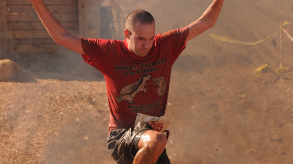 """Yes, that's a guy leaping over fire. The nationwide <a href=""""http://www.ruggedmaniac.com/national-events.html"""" target=""""_blank"""" target=""""_blank"""">Rugged Maniac 5K</a> is for the more adventurous among us. It has more than 20 obstacles constructed by licensed contractors."""