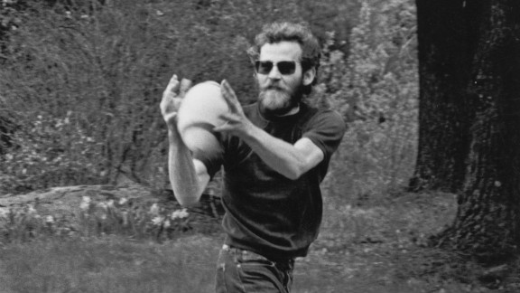 Helm catches a football outside his house, Bearsville, in Woodstock, New York, in 1968.