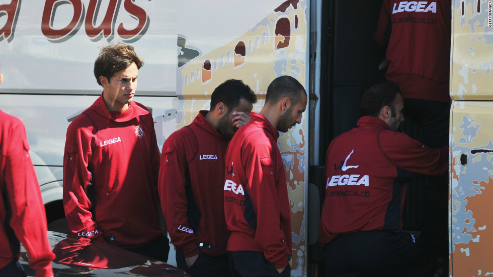 Morosini's Livorno teammates wipe away tears as they leave the ceremony at  Armando Picchi Stadium.