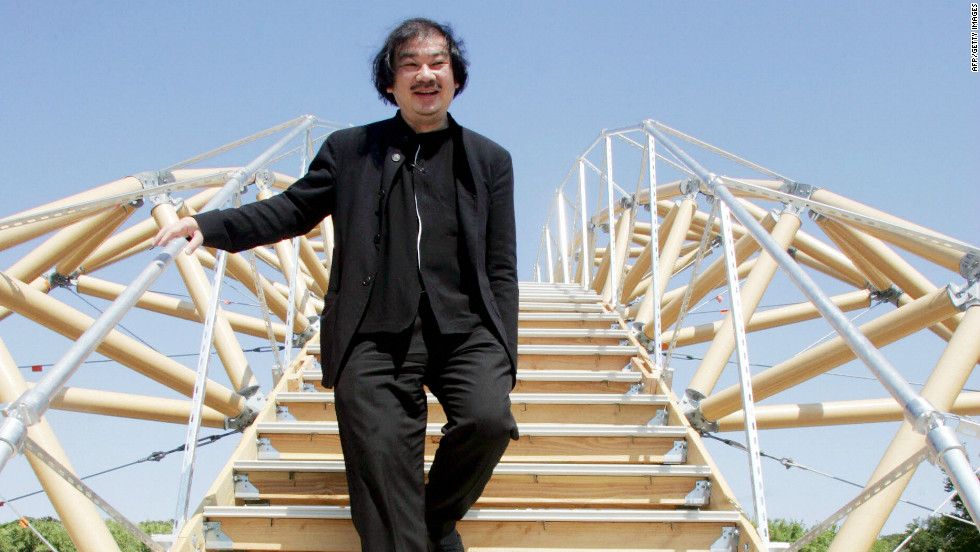 Shigeru Ban walking on his 'paper bridge' when it was unveiled in 2007.
