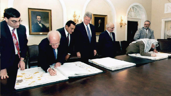 Mubarak, third from left, joins President Bill Clinton, Israeli Prime Minister Yitzhak Rabin, second from left, Jordan's King Hussein, third from right, and Palestinian leader Yasser Arafat, second from right, in Washington in 1995. The Israeli leader and Arafat signed maps representing the redeployment of Israeli troops in the West Bank.