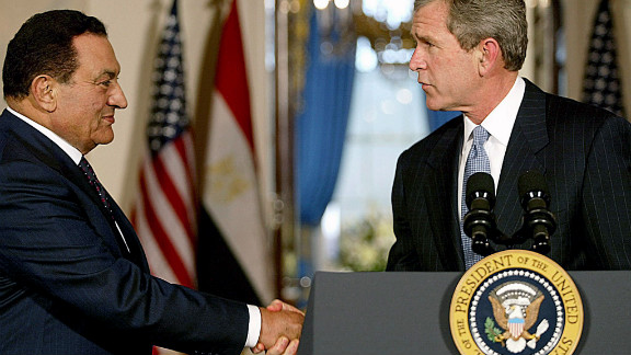US President George W. Bush greets Mubarak at the White House in 2002 to talk about the Middle East crisis and the war in Afghanistan.