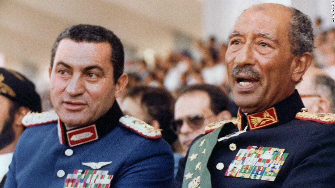 Then-Vice President Mubarak, left, joins President Anwar Sadat at a military parade on October 6, 1981, the day Islamic fundamentalists from within the army assassinated Sadat. Mubarak succeeded Sadat as Egypt's president, maintaining power for nearly three decades.