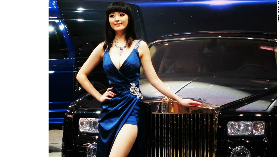 A Woman Models In Front Of Rolls Royce Model Shown At The Auto China