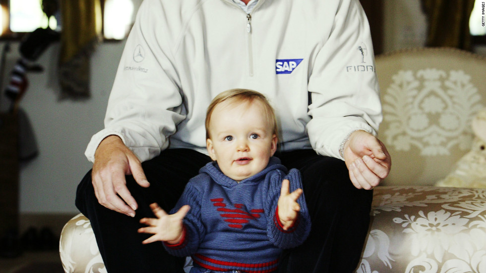 Now nine, the youngster still struggles to speak and attends a specialist school in Florida. He is pictured here with his father in their former home in England in 2003.