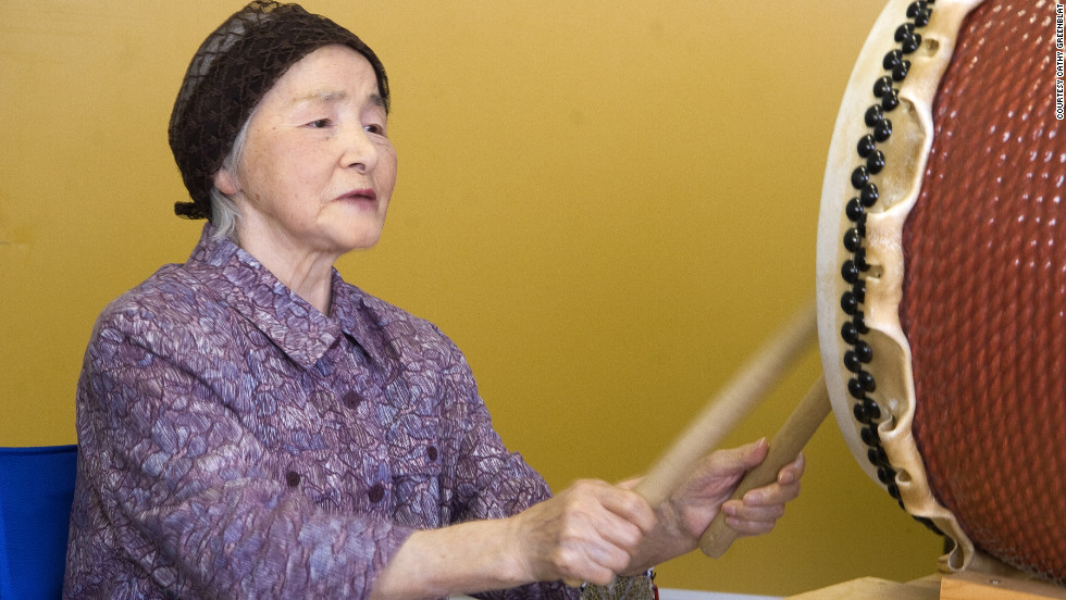 In Japan, this unidentified woman with Alzheimer's enjoyed therapy through music. Joining a drum circle, she became caught up in an intense rhythmic response.
