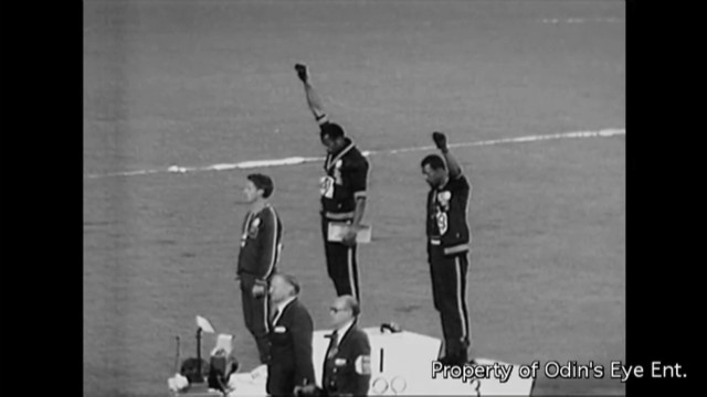 Peter Norman, left, stands in solidarity during the podium protest by Smith and Carlos.