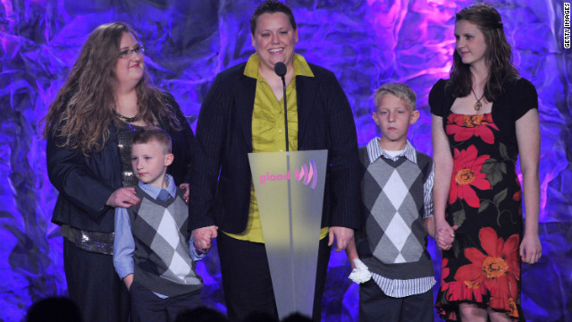 Jennifer Tyrrell, center, and Alicia Burns, left, with children speak onstage at the 23rd Annual GLAAD Media Awards.