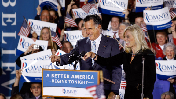Mitt Romney and his wife, Ann, celebrate Tuesday's primary sweep with supporters in New Hampshire.