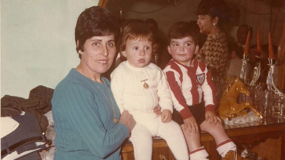 Juan Luis Moreno (center) with his mother and childhood friend Antonio Barroso, another child who was told he had been illegally adopted.