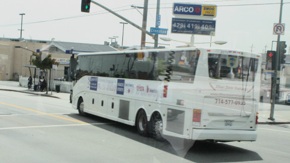 A bus winds its way through south Los Angeles during Operation Hope