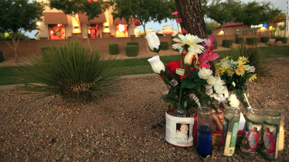 The family placed a memorial on the dirt path outside the Taco Bell where he was killed April 3.