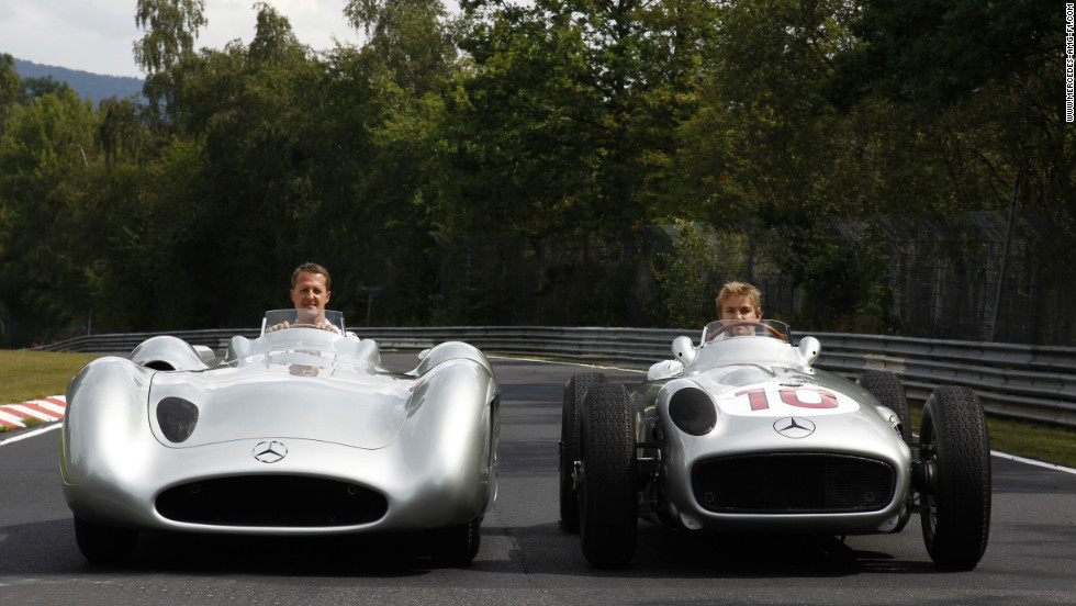 Michael Schumacher In The Modern Silver Arrow While Mercedes Teammate Nico Rosberg Takes Wheel Of