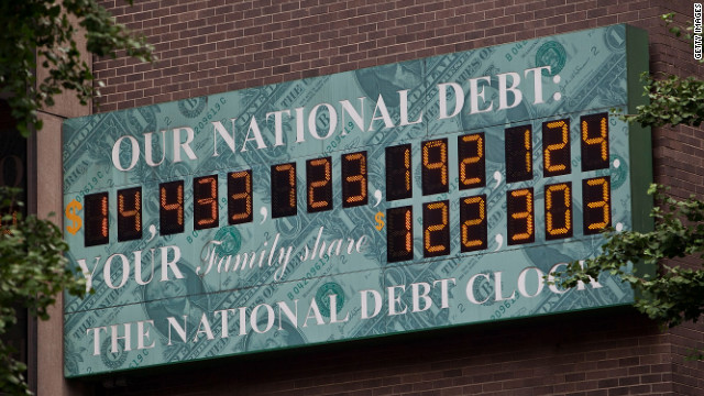 National Debt Clock, a digital display showing the  U.S. debt, sits at Sixth Avenue and West 44th Street in New York .