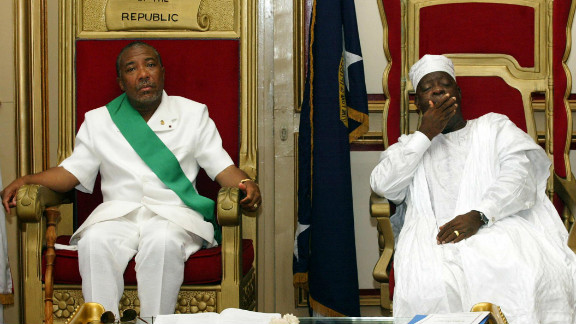 Charles Taylor, left, sits beside Liberia