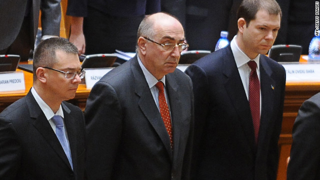 Outgoing Prime Minister Mihai Razvan Ungureanu, left, and members of his government in Parliament on Wednesday.