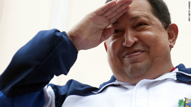 Hugo Chavez salutes at the crowd from a balcony of Miraflores presidential palace in Caracas on April 13, 2012.