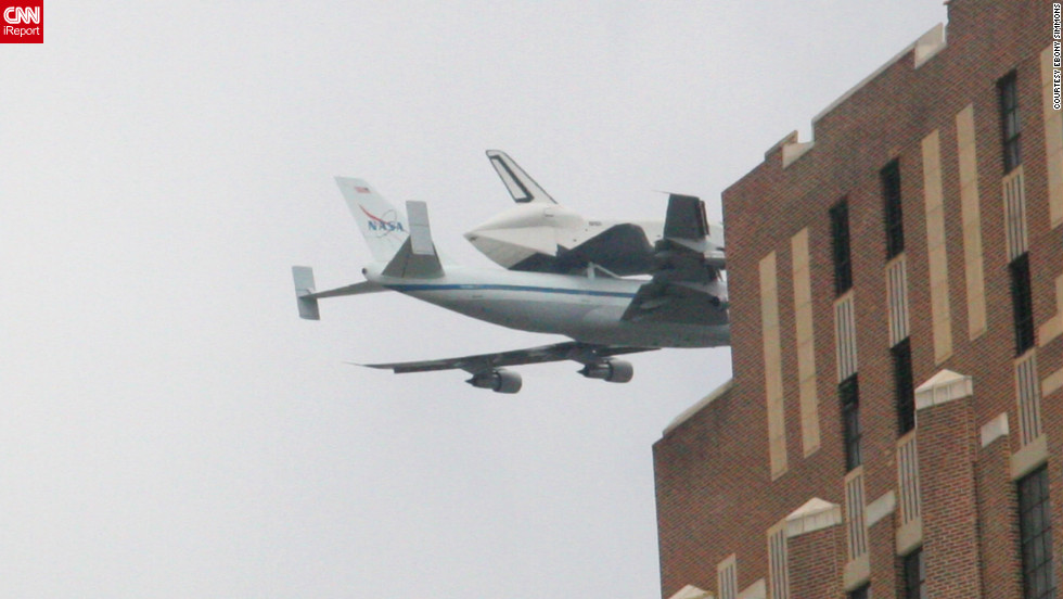 "Ebony Simmons shot these photos of the Enterprise's journey from the roof of her office building. The iReporter said she loves the space program, and that it ""should absolutely NEVER come to an end."""