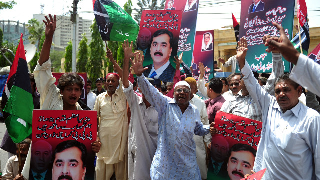 Supporters of the ruling Pakistan Peoples Party (PPP) protest the verdict against Gilani.