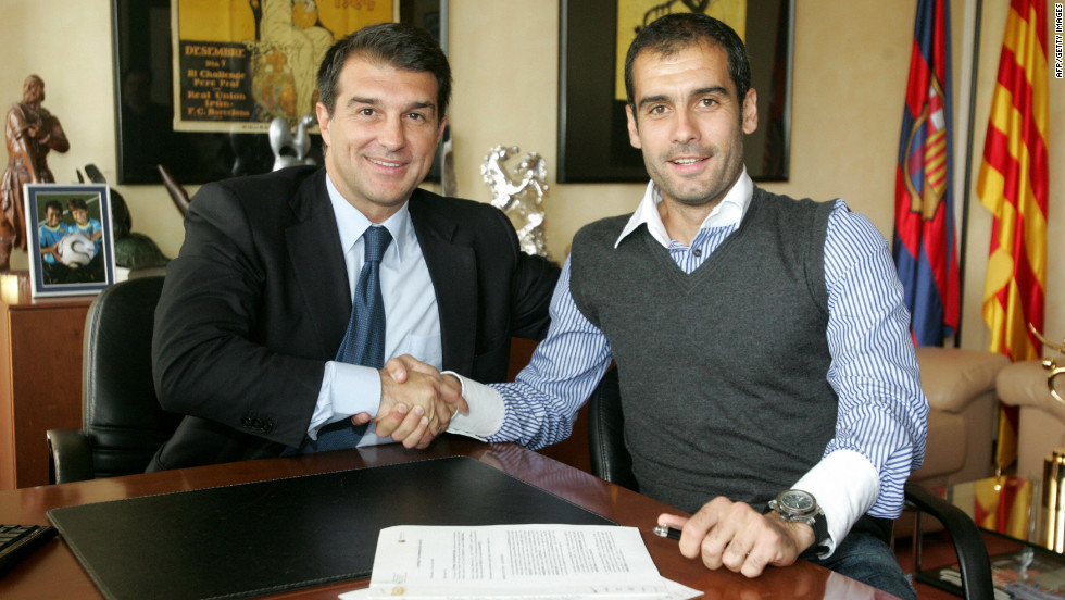 Former Barcelona president Joan Laporta shakes hands with Guardiola on June 5, 2008. The Catalan club's 15th coach arrived with the mission to end a two-season trophy drought -- he didn't disappoint.