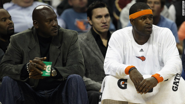 Basketball legend Michael Jordan, left, is the owner of Charlotte Bobcats, now the worst team in NBA history.