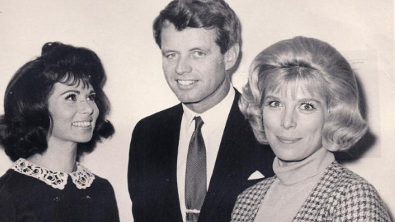 """In this NBC photo taken in December 1965, TV actress Nina Roman, today known as Nina Rhodes-Hughes, left, and her """"Morning Star"""" co-star Elizabeth Perry, right, meet Robert F. Kennedy at NBC's Burbank studios. Two and a half years later, Rhodes-Hughes witnessed Kennedy's assassination."""