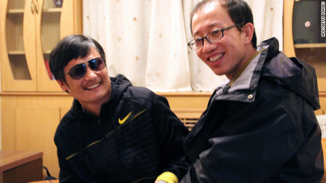 This undated photo shows outspoken government critic Hu Jia, right, sharing a light moment with blind lawyer Chen Guangcheng after his escape, at an undisclosed location in Beijing.