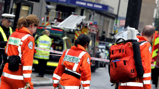 File photo of emergency workers arriving at Edgware Road following an explosion  in London's subway on July 7, 2005