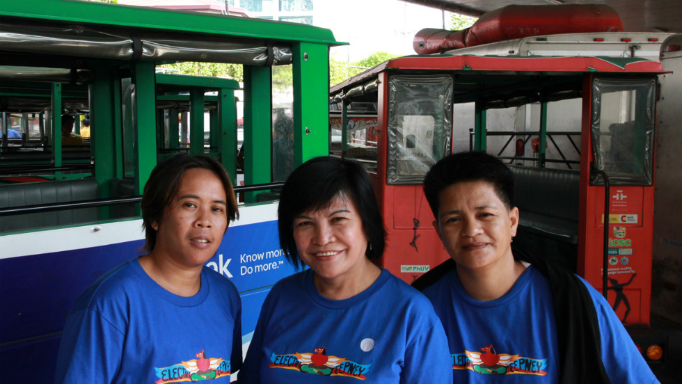 Josefina Barandon (center) and her fellow women e-jeepney drivers.