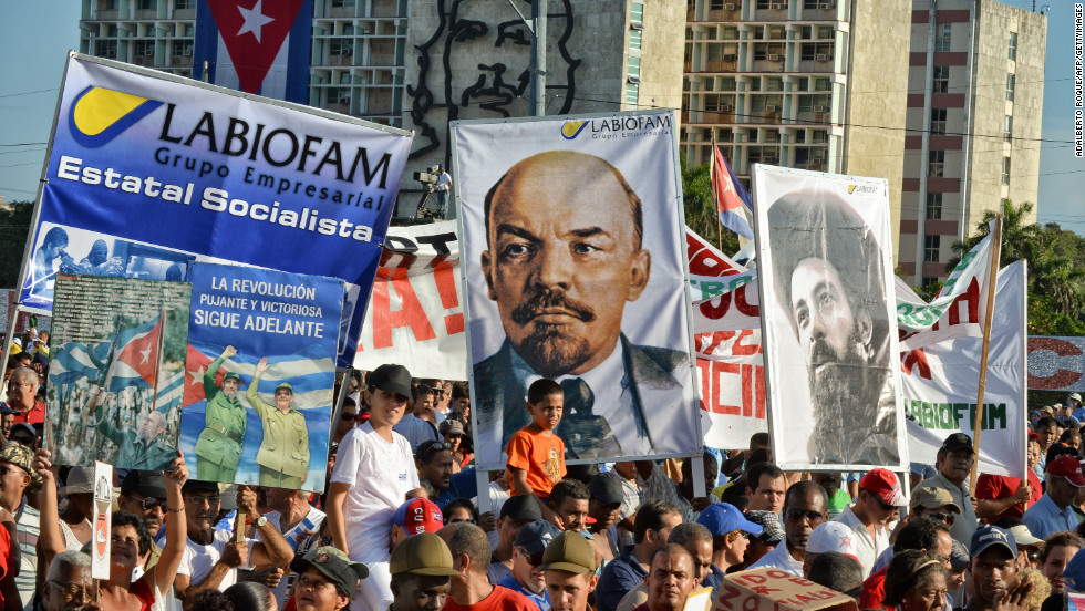Cubans march in Havana on International Labor Day, Tuesday.