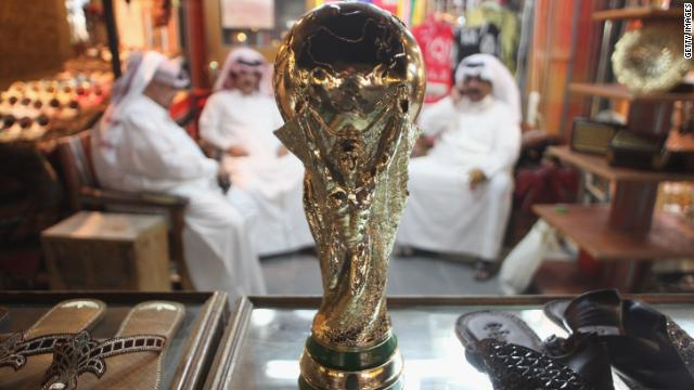In 2010, Qatar won the race to host the 2022 Fifa World Cup, the first Middle Eastern country to do so. The country has promised to combat the fierce summer heat by building fully air-conditioned stadiums. This picture shows a replica World Cup in a shoemaker's stall in Souq Waqif traditional marketn in Doha.