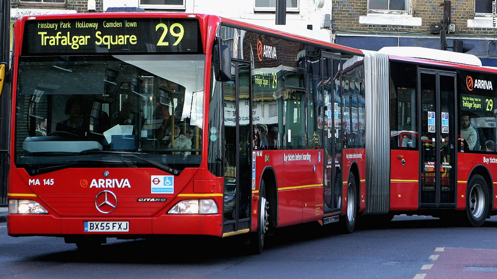 "A ""bendy bus"" travels a route in North London in 2006.  Livingstone introduced  the ""bendy buses,"" snake-like Mercedes vehicles that terrified road-users in London's narrow streets. He also upgraded underground trains and brought in a congestion tax on motorists entering central London."