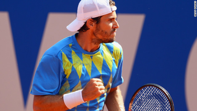 Tommy Haas punches the air with delight after shocking top seed Jo-Wilfried Tsonga in the BMW Open in Munich.