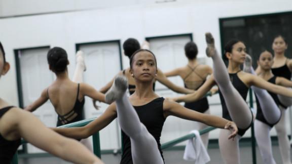 Jessa Balote at the bar of Ballet Manila with fellow aspiring ballerinas
