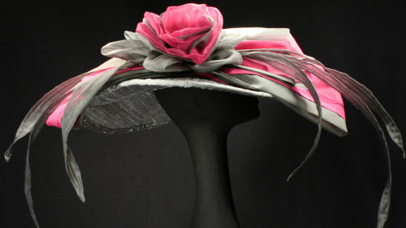 """Steinmann's """"Michaela"""" hat uses dupioni silk to create a wide brim hat, as well as a large rose curl, and one of her trademarks, several silk organza """"feathers."""" She doesn't like to use real feathers."""