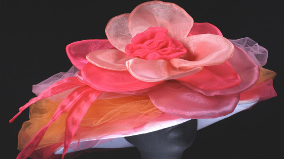 """This """"Candy"""" creation by Steinmann showcases the bright pinks and flowers that Derby-goers love, like the fabric peony that dominates this wide brim design."""