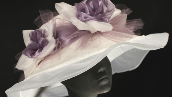 """The ruffled edges of Steinmann's """"Jamie"""" hat have long been a tradition at the Derby, as well as the braiding and bows that adorn the top."""