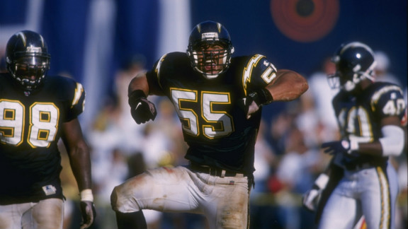 Seau celebrates a defensive stop against the Kansas City Chiefs in 1996.
