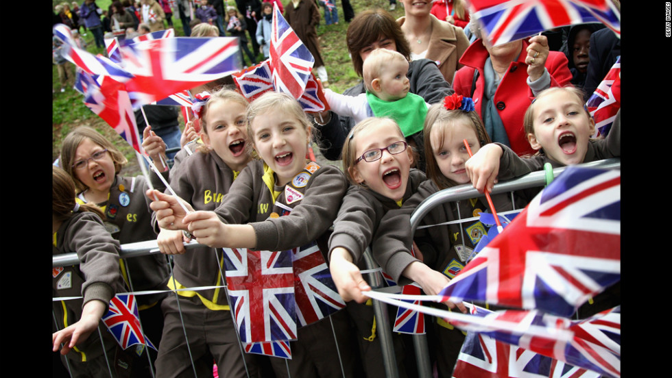 Girls from the Holy Trinity Yeovil Brownies Hamdon Division cheer the arrival of Queen Elizabeth II on Wednesday in Yeovil, England. The queen and the Duke of Edinburgh are on a Diamond Jubilee tour of the country.