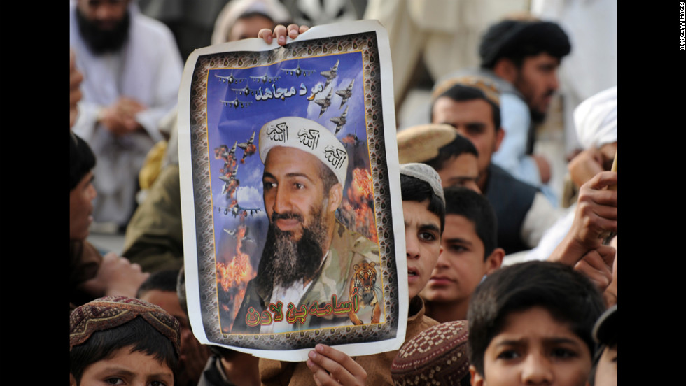 Supporters of hard-line pro-Taliban party Jamiat Ulema-i-Islam-Nazaryati carry portraits of the slain al Qaeda leader Osama bin Laden during an anti-U.S. rally in Quetta, Pakistan on Wednesday, the first anniversary of bin Laden's death.