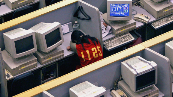 A Chinese broker sleeps on her desk inside the Shanghai Stock Exchange on March 1, 2007 in Shanghai, China. China's stock market experienced its sharpest daily fall in 10 years on February 27, 2007 in spite of the premier's pledges to develop the capital market.