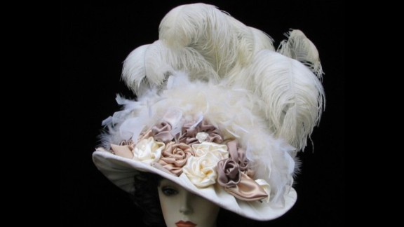 """A classic Derby design, Siverson's """"Triple Crown"""" hat, is piled high with feathers and floral motifs. Large hats full of feathers are a nostalgic reminder of past years."""