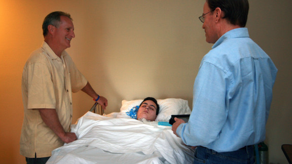 """Bret Buchanan and Bob Hunter, leader of Ryan's youth group, hold a Bible study session. Deeply religious, the Buchanan family has faith that Ryan will recover. """"I asked (the doctors), 'Do you believe in miracles, and have you seen miracles?' """" Buchanan says. """"And they said yes."""""""
