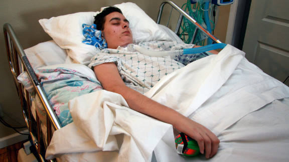Ryan Buchanan, 17, was trapped underground without oxygen for 15 to 20 minutes after a sand tunnel collapsed on him at a beach in June 2011. In a persistent vegetative state, Ryan can breathe on his own but has a tracheostomy tube so his breathing isn't obstructed by his inability to swallow. After months of hospitalizations, his family brought him home in February.