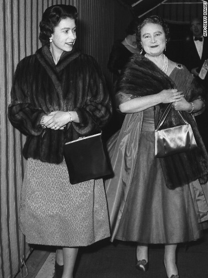 """A relaxed evening at the theater: The Queen Mother and Queen Elizabeth II arrive at Windsor's Theatre Royal for a performance of George Bernard Shaw's """"You Never Can Tell"""" on February 23, 1962."""