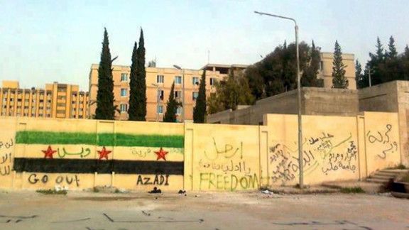 Anti-regime graffiti sprayed on the walls of Aleppo University is shown in this photo from Monday.