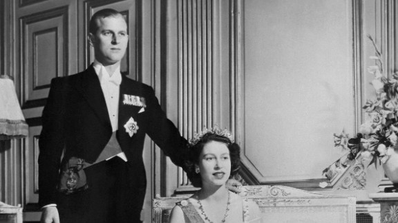 Princess Elizabeth and new husband, Prince Philip of Greece, pose for a royal photographer on their wedding day, 20 November 1947. By all accounts Prince Philip had won the future queen