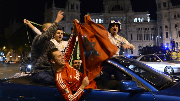 Real Madrid supporters celebrate their team