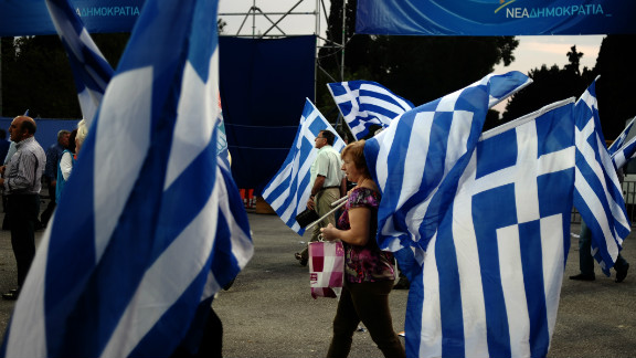 Supporters of Greek conservative party New Democracy gather to listen a speech by the party
